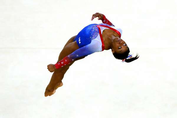 YEAR IN FOCUS - SPORTS (1 of a set of 105) RIO DE JANEIRO, BRAZIL - AUGUST 16:  Simone Biles of the United States competes on the Women's Floor final on Day 11 of the Rio 2016 Olympic Games at the Rio Olympic Arena on August 16, 2016 in Rio de Janeiro, Brazil.  (Photo by Dean Mouhtaropoulos/Getty Images)