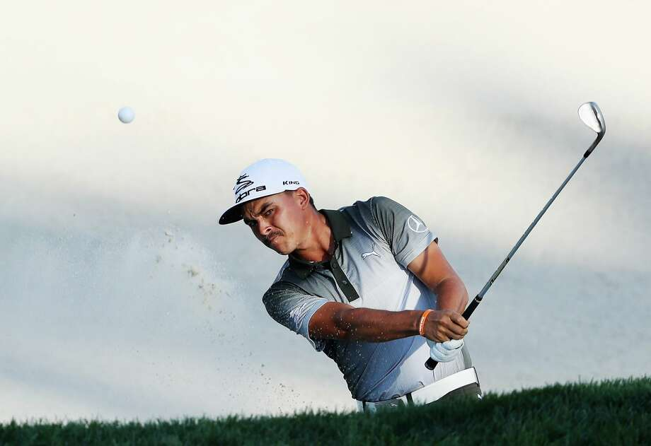 YEAR IN FOCUS - SPORTS (1 of a set of 105) FARMINGDALE, NY - AUGUST 27:  Rickie Fowler plays a bunker shot on the 17th hole during the third round of The Barclays in the PGA Tour FedExCup Play-Offs on the Black Course at Bethpage State Park on August 27, 2016 in Farmingdale, New York.  (Photo by David Cannon/Getty Images) Photo: David Cannon