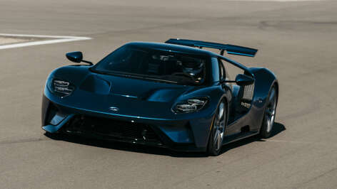 """Ford's new GT, with a 3.5L EcoBoost V6 engine and more than 600 horsepower, has an aerodynamic shape that """"allows it to cut through the air unlike any Ford production car before it,"""" according to the company. Road & Track writer Bob Sorokanich and photographer Kevin McCauley observed road tests of 2017 GT prototypes at Las Vegas Motor Speedway in early December, 2016. ( Road & Track )"""