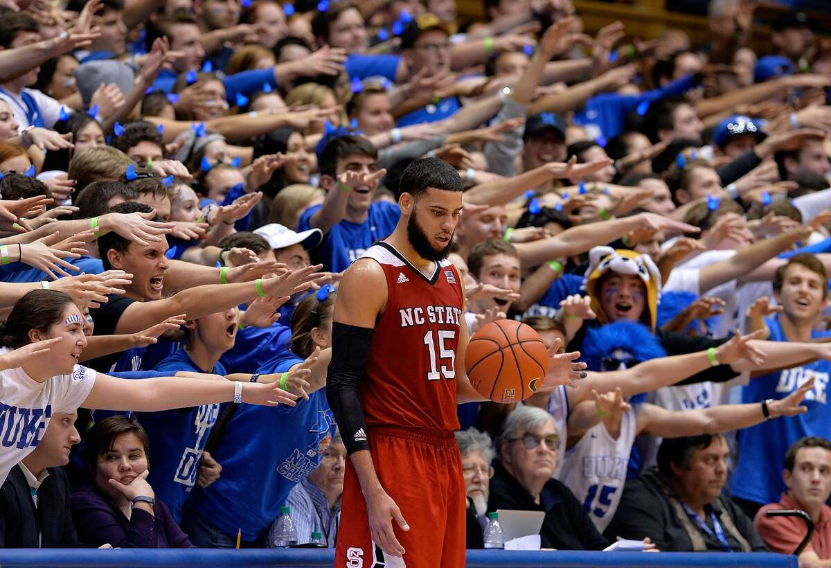 YEAR IN FOCUS - SPORTS (1 of a set of 105) DURHAM, NC - FEBRUARY 06: The Cameron Crazies taunt Cody Martin #15 of the North Carolina State Wolfpack during their game against the Duke Blue Devils at Cameron Indoor Stadium on February 6, 2016 in Durham, North Carolina. Duke won 88-80. (Photo by Grant Halverson/Getty Images)