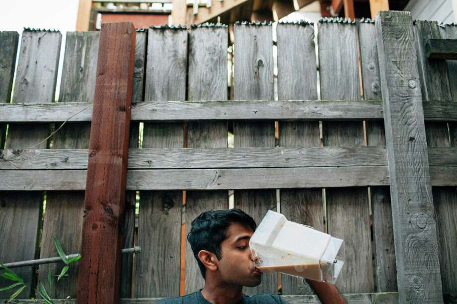Software engineer Pulak Mittal drinks Soylent, a meal replace-ment drink on the rise in the tech industry, in San Francisco.  Photo: PETER EARL MCCOLLOUGH, STR / NYTNS