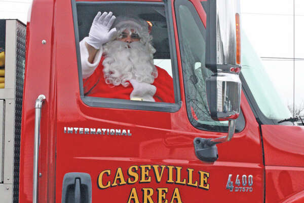 No Children's Christmas event would be complete without this jolly old soul. Santa was the guest of honor at the Annual Caseville Eagles Auxiliary and Aerie and the Caseville Kiwanis Luncheon. The event was free to all kids in fourth grade and younger. Caseville Chamber of Commerce Coordinator Deb Fulgham said: 'Santa came on a fire truck to rest the reindeer for the big day. Plus, so many children ask for fire trucks that he thought it would be a fun idea.'