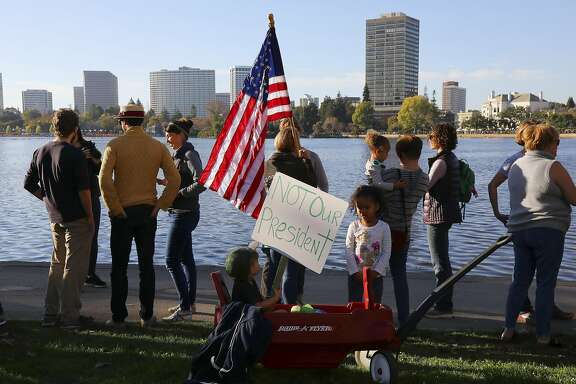 Kaya, 2, and Sai Mattia, 4, with their wagon during a peaceful protest of Donald Trump�s election as president that organizers called Hands Around Lake Merritt, in Oakland, Calif. Nov. 13, 2016. (Jim Wilson/The New York Times)
