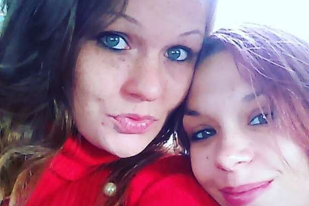 Tiffany Fitzgerald, right, is shown here posing with her sister, Amanda Fitzgerald.