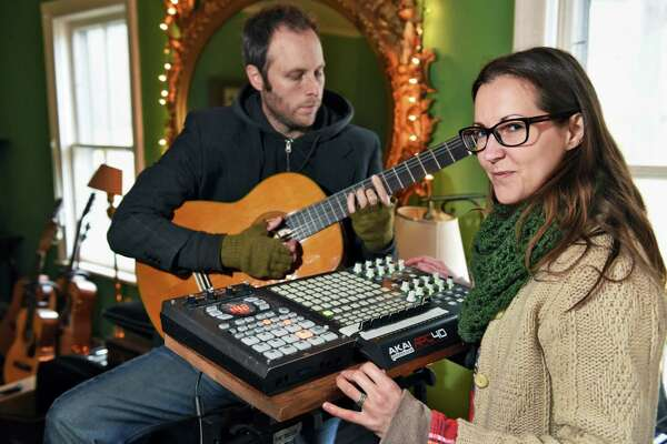 Eric Krans and Jen O'Connor of the band The Parlor in their home recording studio Saturday Dec. 3, 2016 in Altamont, NY.  (John Carl D'Annibale / Times Union)