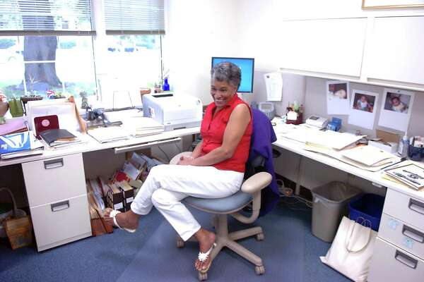 Charlene Abdal in her Town Hall office in 2009, retiring after 33 years with the town and serving as an executive assistant to some 12 First Selectman. She died Sunday after a long illness.
