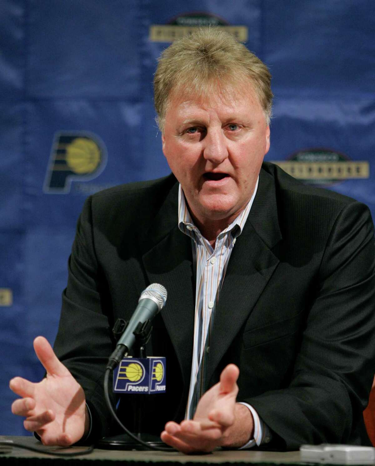 Indiana Pacers president Larry Bird announces that coach Rick Carlisle will not return to coach the team during a news conference in Indianapolis, Wednesday, April 25, 2007. Carlisle coached the team for four season and compiled a 181-147 record. The Pacers missed the playoffs this season with a record of 35-47. (AP Photo/Michael Conroy)