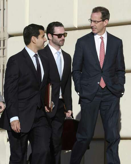 Attorney Todd Prins, right, accused of fabricating court documents and forging judges' signatures in clients' cases, arrives Tuesday morning, Dec. 6, 2016 at the Hipolito Garcia Federal Building and U.S. Courthouse for a creditors' meeting. Photo: William Luther, Staff / San Antonio Express-News / © 2016 San Antonio Express-News