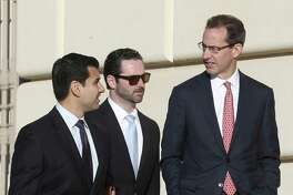 San Antonio attorney Todd Prins, right, is accompanied by his lawyers Carlos Solis, left, and Derek Hilley, just before they enter the Hipolito Garcia Federal Building and U.S. Courthouse for a creditors meeting Tuesday. Prins and his wife filed for Chapter 7 liquidation in September and he has been accused of fabricating court document and forging judges' signatures in a case involving former clients.