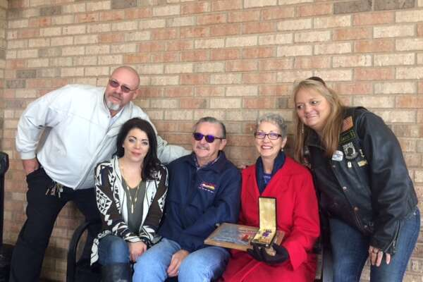 Gary Kennedy, from left, Amy Davis, and Sandy Dunlap, right, traveled to Tye from Midland on Tuesday to give Tommy and Nancy Carter, center, a Purple Heart and other military medals that had belonged to Tommy Carter's uncle, Jim Carter.