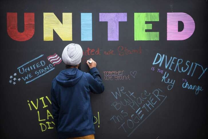 Texas A&M graduate student Harsimran Singh signs an Aggies United board calling for unity in the wake of a speech being held by White Nationalist Richard Spencer on the campus of Texa A&M University on Tuesday, Dec. 6, 2016, in College Station.