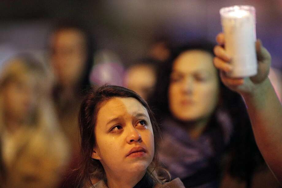 Artist Kenzie Borland is one of the mourners at a vigil for victims of the Ghost Ship fire in Oakland that was held Tuesday night at Castro and Market streets in San Francisco. Photo: Paul Kuroda, Special To The Chronicle