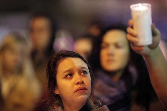 Kenzie Borland, an artist, cries  at a vigil for the December 2, 206 Oakland warehouse fire that killed at least 36 people in the San Francisco, CA. Castro District on Monday, December 5, 2016, Castro St. and Market.