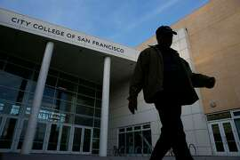 """City College of San Francisco alum and proud parent of current student Jaime Moran walks through the main campus on Wednesday January 14, 2014 in San Francisco, Calif. The accrediting commission granted CCSF two more years to get everything in order to avoid losing accreditation. """"It's great new for everyone,"""" said Moran."""