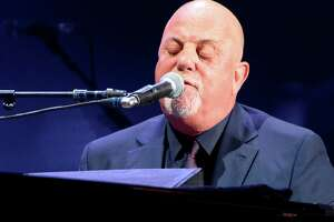 Billy Joel performs live on stage at Madison Square Garden on August 9, 2016 in New York City.
