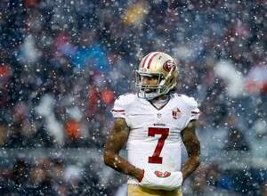 CHICAGO, IL - DECEMBER 04:   Quarterback Colin Kaepernick #7 of the San Francisco 49ers warms his hands in the third quarter against the Chicago Bears at Soldier Field on December 4, 2016 in Chicago, Illinois.  (Photo by Joe Robbins/Getty Images)