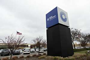 A United Technologies Corp. sign stands outside the Carrier Corp. facility in Indianapolis, Indiana, U.S., on Thursday, Dec. 1, 2016. President-elect Donald Trump, who spoke at the plant today, said he called the top executive of United Technologies Corp., shortly after his election and told him not to close a Carrier factory in Indianapolis that became a symbol of the Republican's outsider campaign for the White House. Photographer: Daniel Acker/Bloomberg