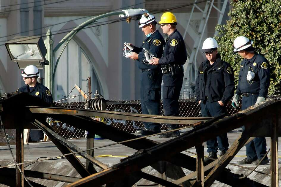Alameda County Sherrif's officers keep an eye on a quadcopter that they used to look into the destroyed Ghost Ship warehouse as recovery efforts came to a close following the fire that claimed 36 lives in Oakland, Calif., on Tuesday, December 6, 2016.