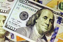 This Feb. 2, 2015, photo depicts a part of a U.S. $100 bill. Who gets what share of the federal budget pie has shifted over the decades, with the military taking less and entitlement programs like Social Security, Medicare and Medicaid getting far more. Education, housing and labor are also coping with smaller shares. Think of the president's proposed $4 trillion dollar budget proposal as just a $100 bill, here's how much each department would get if the president has his way and how they compare to past actual spending. (AP Photo/Jon Elswick)