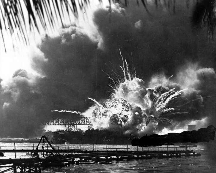 Smoke and flame are seen as the magazine explodes on the destroyer USS Shaw during the Japanese attack on Pearl Harbor, Hawaii, on Dec. 7, 1941.