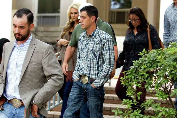 Brian Goetz, center, walks out of the Montgomery County Courthouse after testimony concluded in an intoxication manslaughter trial Tuesday, Nov. 8, 2016, in Conroe. Goetz was convicted of a lesser charge of driving while intoxication and sentenced to six months in jail.