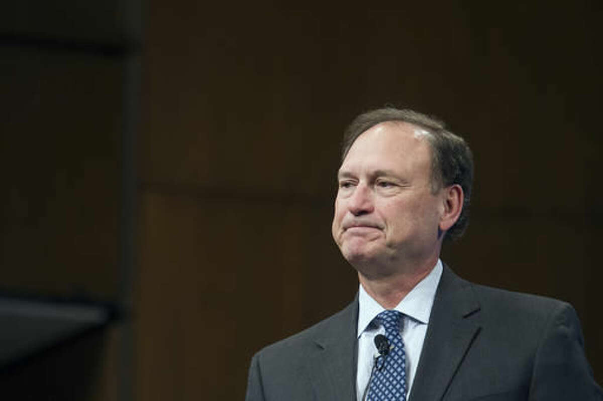 FILE - In this Feb. 23, 2016, file photo, Supreme Court Justice Samuel Alito pauses while speaking at Georgetown University Law Center's third annual Dean's Lecture to the Graduation Class, in Washington. Two Supreme Court justices and nine judges on President-elect Donald Trump's list of potential high court picks are among more than 1,000 people expected at a gathering of conservative lawyers that has suddenly turned into an impromptu job fair for spots in the new administration. The Federalist Society's national lawyers' convention begins Nov. 17 in Washington as a tribute to the late Justice Antonin Scalia, an early supporter of the group and a hero to many of its 40,000 members. (AP Photo/Cliff Owen, File)