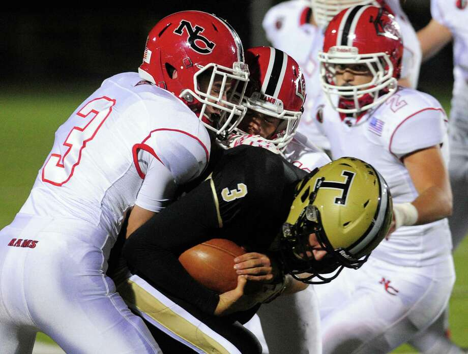 High school football action between New Canaan and Trumbull in Trumbull, Conn. on Friday Nov. 4, 2016. Photo: Christian Abraham / Hearst Connecticut Media / Connecticut Post