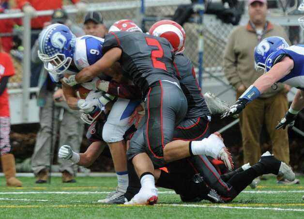 Photos from Darien's 37-34 win over New Canaan in the Turkey Bowl high school football game at Dunning Stadium in New Canaan, Conn. Thursday, Nov. 24, 2016. New Canaan scored 24 unanswered points to tie the game and force an overtime. In overtime, Darien kicked a field goal to take the lead and forced a New Canaan interception to end the game, setting off a wild celebration as fans stormed the field. Photo: Tyler Sizemore / Hearst Connecticut Media / Greenwich Time