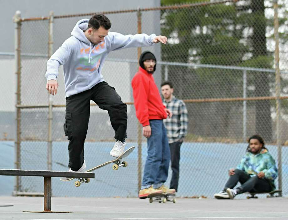 Dylan Zhang of Albany performs a front side board slide at the make shift skate park in Washington Park on Tuesday, Dec. 6, 2016 in Albany, N.Y. (Lori Van Buren / Times Union) Photo: Lori Van Buren