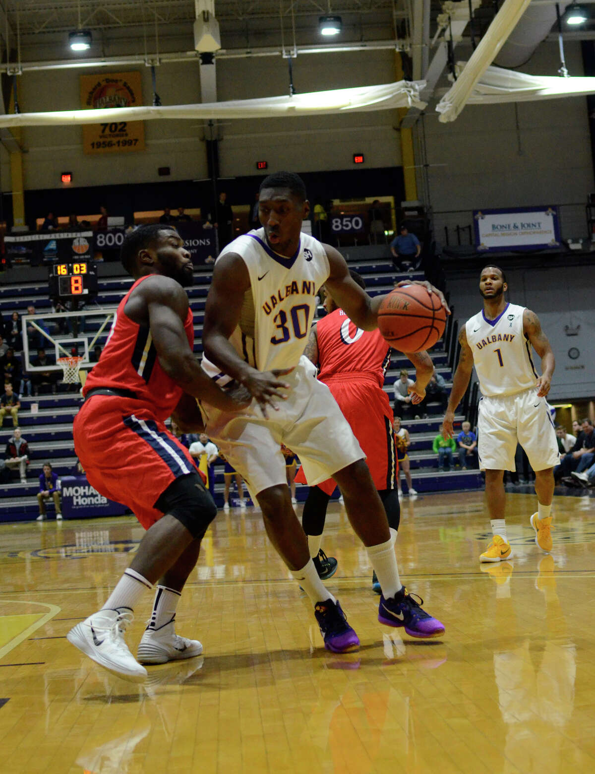 UAlbany forward Travis Charles moves past New Jersey Institute of Technology guard Rob Ukawuba during the Naismith Basketball Hall of Fame Classic, Friday, Nov. 27, 2015, at University at Albany in Albany, N.Y. (Jenn March/Special to the Times Union)