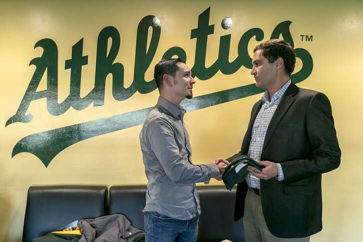 From left: Dave Kaval, president of the Oakland Athletics, and Shaun Aguilar chat at the O.co Coliseum on Tuesday, Dec. 6, 2016 in Oakland, Calif. Kaval held a 2-hour open house with fans and invited them to a one-on-one chat at his office.