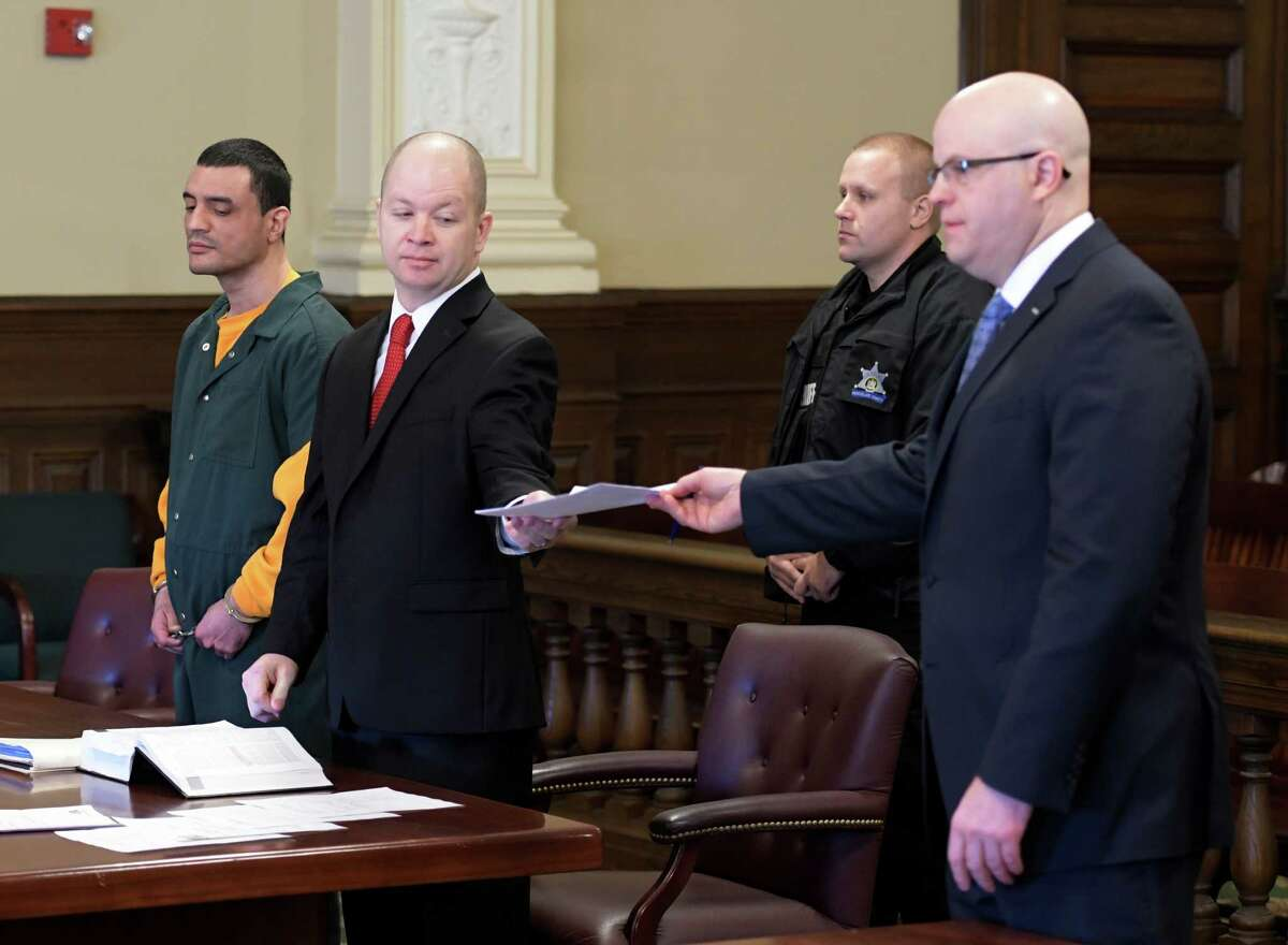 Johnny Oquendo, left appears in Rensselaer County Court with his attorney William Roberts for his arraignment for the alleged murder of his step daughter Noel Alkaramla Tuesday Dec. 6, 2016 Troy, N.Y. Representing the prosecution is Rensselaer County District Attorney Joel Abalone, right. (Skip Dickstein/Times Union)