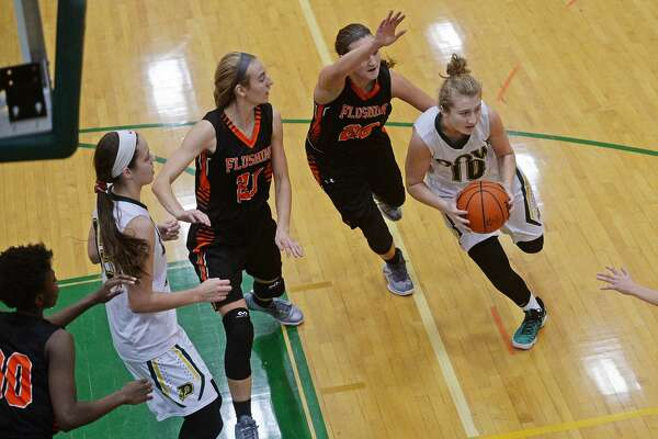 From left, Flushing's Breanna Perry, Dow's Nadia Atton, Flushing's Madeline Morrison and Carson Wilson watch as Dow's Ellie Taylor dribbles the ball on Tuesday at H.H. Dow High School.