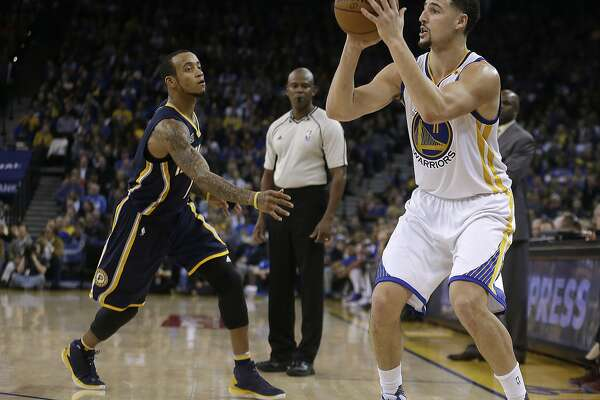 Golden State Warriors' Klay Thompson, right, shoots against Indiana Pacers' Monta Ellis during the third quarter of an NBA basketball game Monday, Dec. 5, 2016, in Oakland, Calif. (AP Photo/Ben Margot)