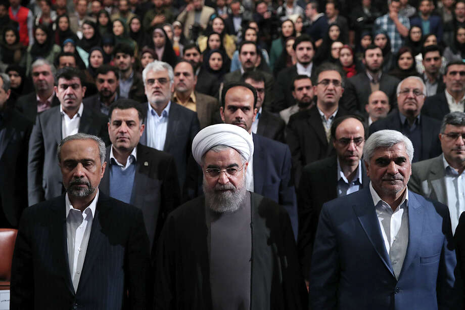 "In a handout photos from the Iranian Presidency, Iranian President Hassan Rouhani, center, in Tehran, Dec. 6, 2016. Rouhani said on Tuesday that he simply would not allow President-elect Donald Trump to tear up last year's nuclear agreement and warned of unspecified consequences if he did. ""America is our enemy; we have no doubt about this. The Americans want to put as much pressure on us as they can,"" said Rouhani. (Iranian Presidency via The New York Times) -- EDITORIAL USE ONLY. -- Photo: IRANIAN PRESIDENCY, HO / IRANIAN PRESIDENCY"