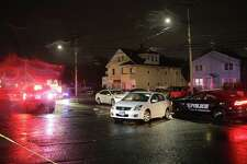 Vehicles involved in a pedestrian injury incurred on the 2900 block of Boston Avenue, Bridgeport, CT, Dec. 6, 2016. Police say the man was hit by the first white car and pinned by the second one.