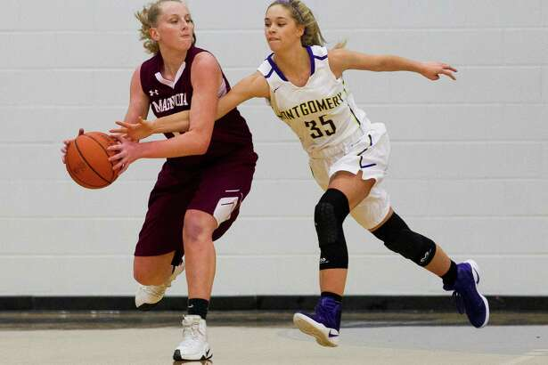 Montgomery power forward Savannah Wendt (35) reaches to knocks the ball away from Magnolia forward Kirby Ritter (32) during the first quarter of a non-district high school girls basketball game at Montgomery High School Tuesday, Dec. 6, 2016, in Montgomery.
