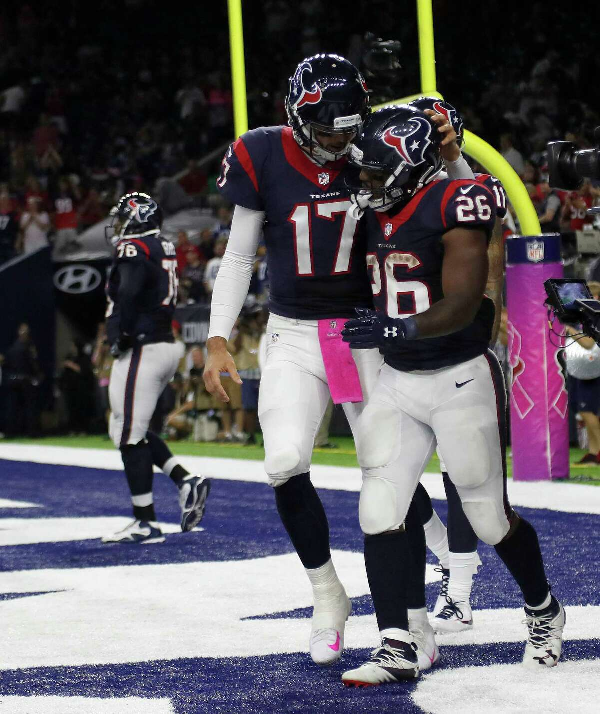 Brock Osweiler (17) congratulates Lamar Miller on the catch-and-run scoring play that launched the Texans' comeback against the Colts in October.