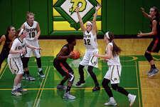ERIN KIRKLAND | ekirkland@mdn.net Dow's Quinn McCaffrey guards Flushing's Breanna Perry on Tuesday at H.H. Dow High School.