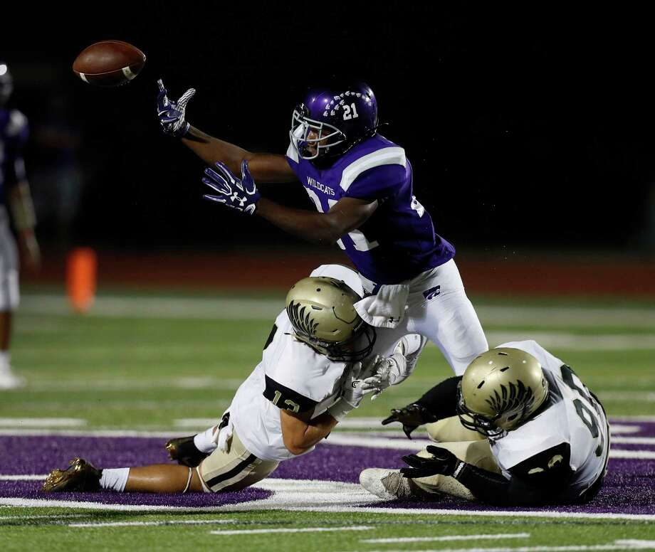 Foster's defense has shown a knack for creating turnovers, like this fumble against Angleton caused by Lane Eldridge, left, and Chidozie Nwankwo. Photo: Karen Warren, Staff Photographer / 2016 Houston Chronicle