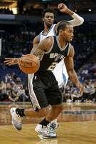 San Antonio Spurs forward Kawhi Leonard (2) dribbles around Minnesota Timberwolves forward Andrew Wiggins (22) in the first half of an NBA basketball game Tuesday, Dec. 6, 2016, in Minneapolis. The Spurs won 105-91. (AP Photo/Bruce Kluckhohn)