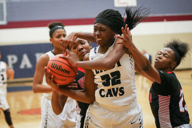 College Park's Jasmine Atobajeun (32) battles for a rebound during the varsity girls basketball game against Westfield on Tuesday, Dec. 6, 2016, at College Park High School. (Michael Minasi / Chronicle)