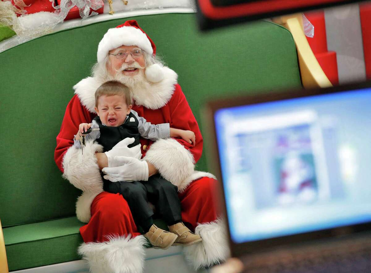 Cry for me: Is the little boy afraid or is this just a mean Santa who pinches? We'll never know.