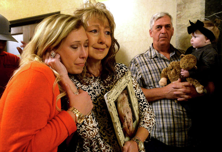 Kasidi Thibodeaux and her mother Teri Thibodeaux hug while consoling one another following a prayer during the Coalition for Victims of Violent Crime's annual Angel Tree ceremony Tuesday night at the Jefferson County Courthouse. The family attended the event for the first time to honor Robbie Allen, Teri's mother, who was a victim of homicide in December, 2011. Families who have lost loved ones to violence gathered to support one another as they remembered and paid tribute to those lost, hanging Christmas ornaments in their honor on the tree.  Photo taken Tuesday, December 6, 2016 Kim Brent/The Enterprise Photo: Kim Brent / Beaumont Enterprise
