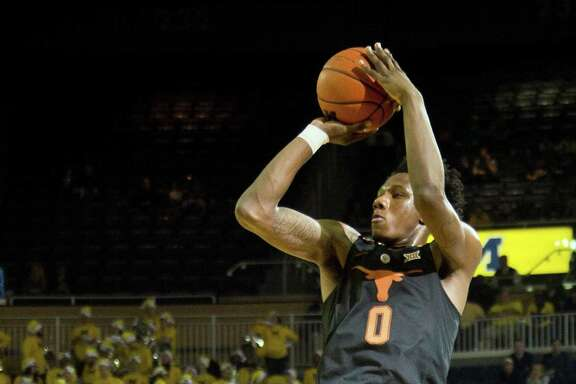 Tevin Mack, who scored a team-high 18 points, shoots a 3-pointer during the first half of the Longhorns' loss.