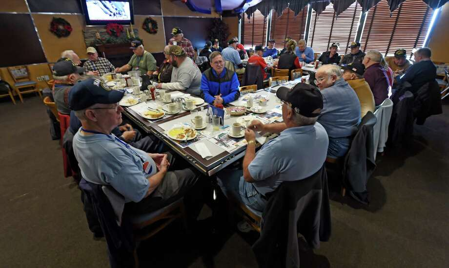 A large group of veterans gather and tell their tales of their different war experiences spanning time from WWII to the present middle east war on Friday, Dec. 2, 2016, at the Gateway Diner in Albany, N.Y. (Skip Dickstein/Times Union) Photo: SKIP DICKSTEIN / 20039034A