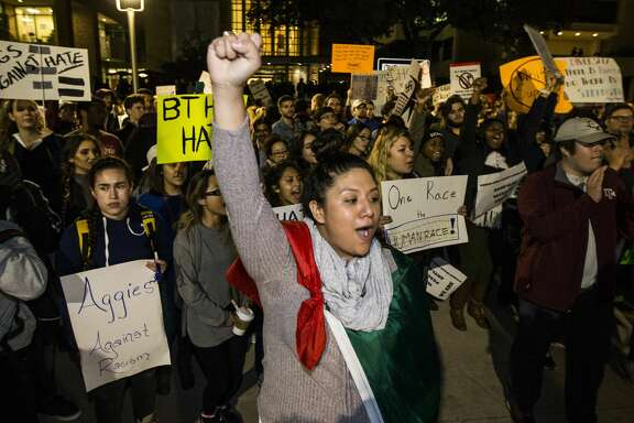 Demonstrators march on the Texas A&M University campus where Richard Spencer, who leads a white nationalist organization, was speaking Tuesday, Dec. 6, 2016, in College Station, Texas. Hundreds of people protested the white nationalist's speaking engagement. (Brett Coomer/Houston Chronicle via AP)