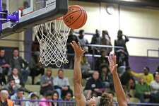 South Colonie's Will Aybar goes in for a score during their high school boy's basketball game against Troy on Tuesday Dec. 6, 2016 in Troy, N.Y. (Michael P. Farrell/Times Union)
