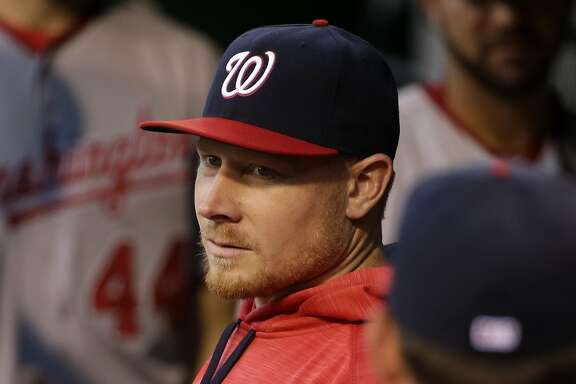 Washington Nationals' Mark Melancon stands in the dugout before a baseball game against the Pittsburgh Pirates in Pittsburgh, Friday, Sept. 23, 2016. (AP Photo/Gene J. Puskar)