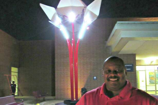 Edwin Love, Humble resident and CEO of Alternative Lighting and Power, poses for a photo in front of the Na3light Solar Tree installed at Stafford Performing Arts Theatre and Convention Centre Nov. 16 in Stafford.